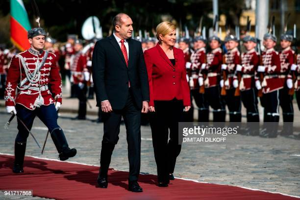 Bulgaria's President Rumen Radev and his Croatia's counterpart Kolinda GrabarKitarovic review honour guards during an official welcome ceremony in...