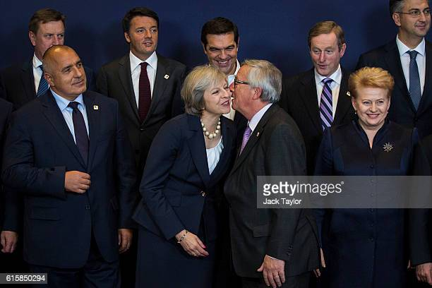 Bulgaria's Prime minister Boyko Borissov British Prime Minister Theresa May kissing President of the European Commission JeanClaude Juncker and...