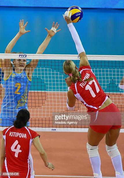 Bulgaria's Strashimira Filipova in action against Lyudmila Issayeva of Kazakhstan during the 2014 FIVB Volleyball Women's World Championship Group F...