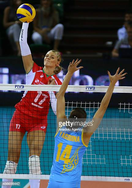 Bulgaria's Strashimira Filipova in action against Yana Yagodina of Kazakhstan during the 2014 FIVB Volleyball Women's World Championship Group F...