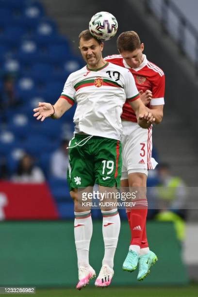 Bulgaria's striker Atanas Iliev and Russia's defender Igor Diveev vie for the ball during the friendly football match Russia v Bulgaria in Moscow on...