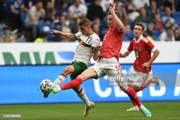 Bulgaria's striker Kiril Despodov and Russia's defender Andrey Semyonov vie for the ball during the friendly football match Russia v Bulgaria in...