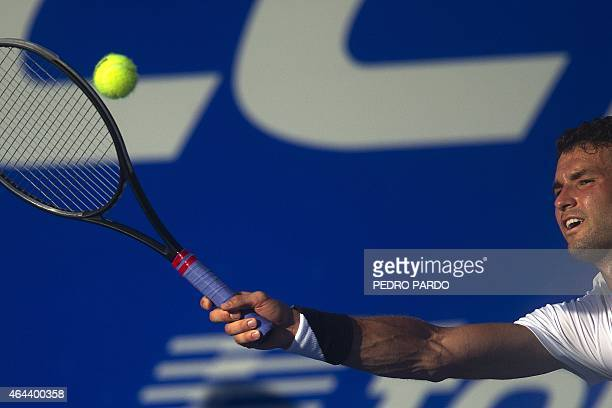 Bulgaria's tennis player Grigor Dimitrov returns the ball to US Ryan Harrison during the Mexico ATP tournament in Acapulco Guerrero State on February...