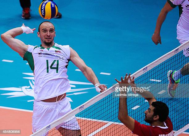 Bulgaria's Teodor Todorov attacks against Egypt's Mamdouh Abdelrehim during the FIVB World Championships match between Bulgaria and Egypt on...