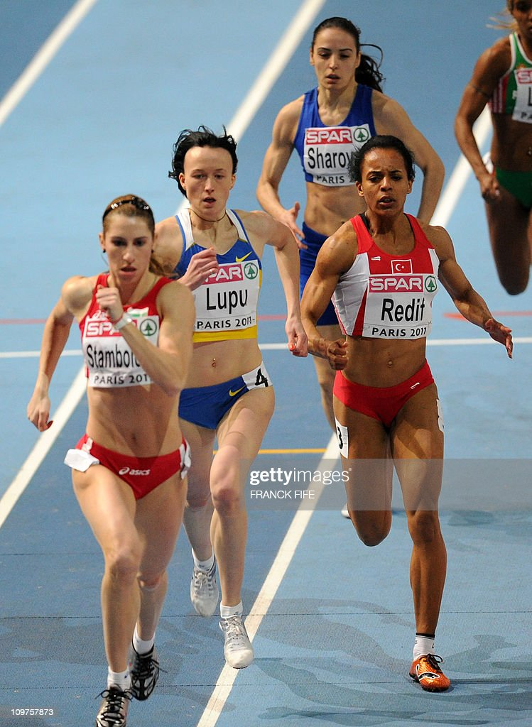 Bulgaria's Vania Stambolova (L), Ukraine's Nataliya Lupu (C) and Turkey's Meliz Redif compete in the 400m women's event of the European athletics indoor championships on March 4, 2011 at the Bercy Palais-Omnisport (POPB) in Paris.