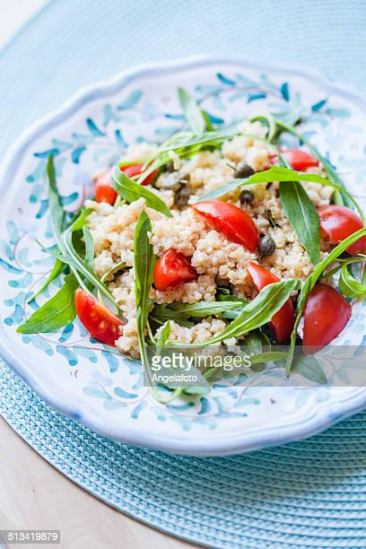bulgur salad with tomatoes and arugula - tabbouleh stock pictures, royalty-free photos & images