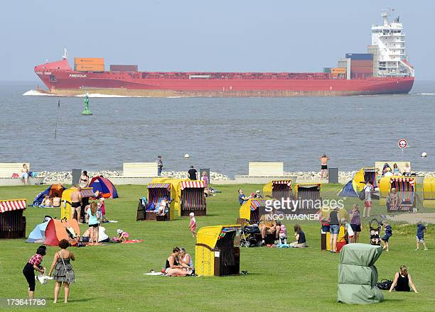 A bulk carrier is seen off the beach of Otterndorf on the Elbe river Germany on July 16 2013 AFP PHOTO / DPA / INGO WAGNER GERMANY OUT