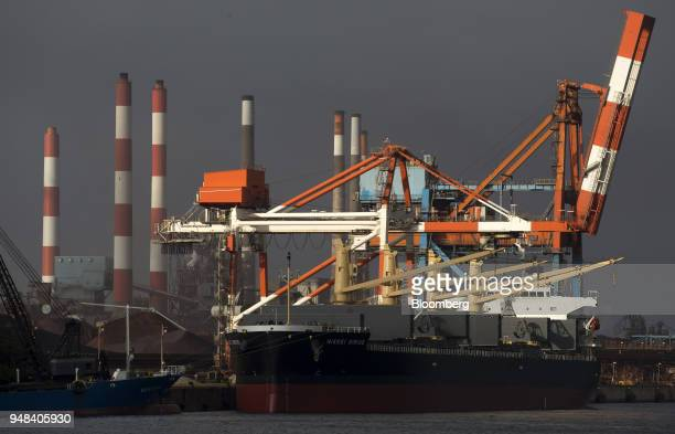 A bulk carrier ship sits moored at the Nippon Steel Sumitomo Metal Corp plant in Kashima Ibaraki Japan on Wednesday April 18 2018 President Donald...
