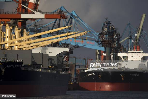 Bulk carrier ships sit moored at the Nippon Steel Sumitomo Metal Corp plant in Kashima Ibaraki Japan on Wednesday April 18 2018 President Donald...