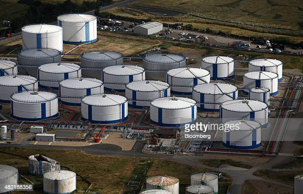 Bulk liquid fuel tanks stand on the Oikos Storage Ltd facility on Canvey Island in this aerial photograph taken near Canvey Island UK on Wednesday...