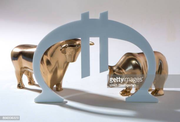 Bull and bear symbol for the ups and downs at the stock markets of the world The photo shows bull and bear with the euro logo