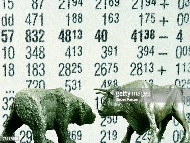 bull and bear with financial data in background - bullmarkt stockfoto's en -beelden