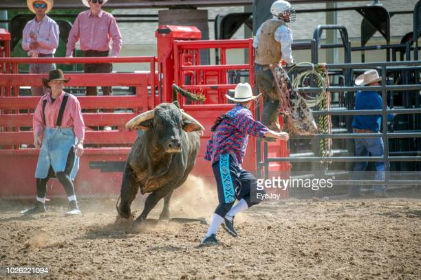 bull chases cowboy rodeo clown - boise idaho stock pictures, royalty-free photos & images