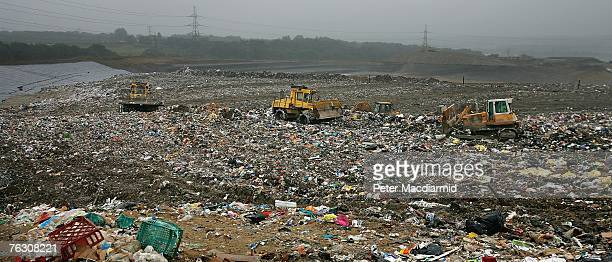 Bull dozers move a mountain of rubbish at the Shelford Landfill Recycling Composting Centre on August 23 2007 near Canterbury England The Shelford...