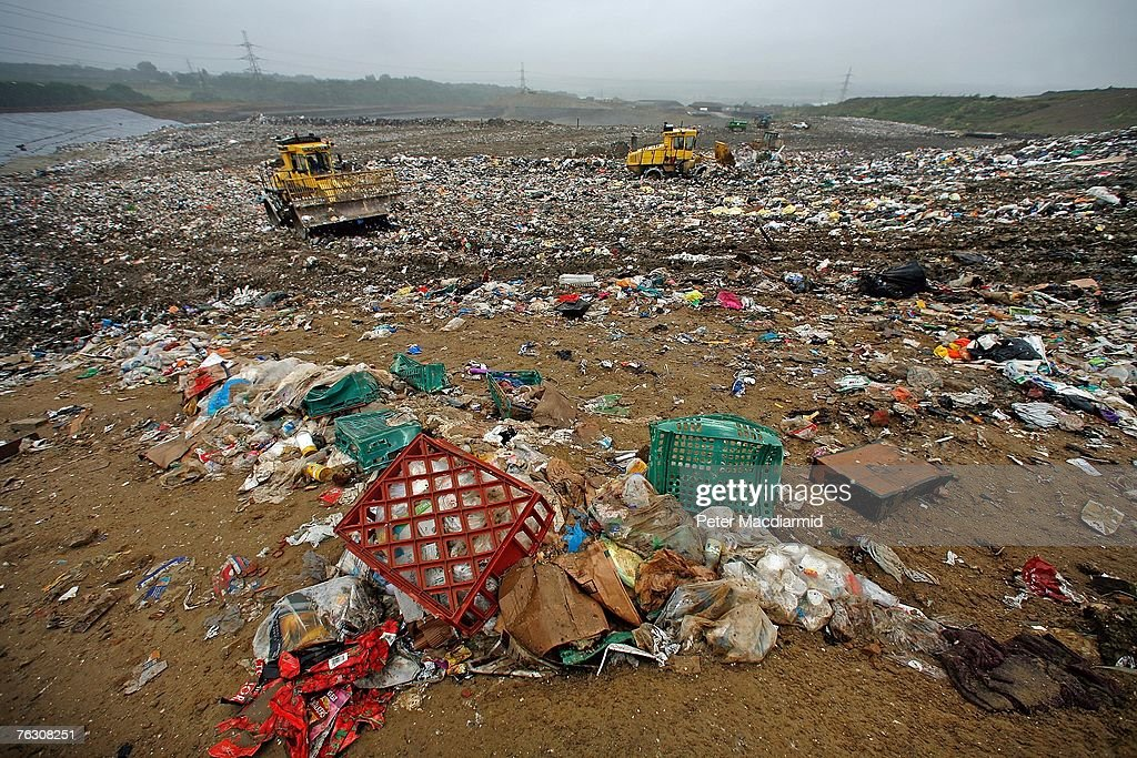 Bull dozers move a mountain of rubbish at the Shelford Landfill, Recycling & Composting Centre on August 23, 2007 near Canterbury, England. The Shelford landfill site, run by Viridor Waste Management receives 200 truck loads of waste weighing 2100 metric tonnes a day.