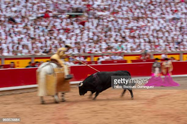 A bull from Puerto de San Lorenzo's fighting bulls runs during a bullfight on the second day of the San Fermin Running of the Bulls festival on July...