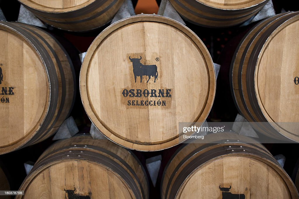 Bull Logos Sit On Decorative Wine Barrels At The Offices Of