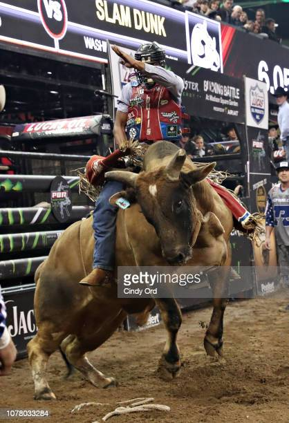Bull rider Alisson De Souza rides Slam Dunk during the 2019 Professional Bull Riders Monster Energy Buck Off at the Garden Unleash the Beast event at...