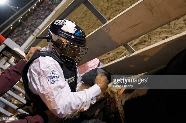 Bull rider Chad Everett Denton of Berry Creek CA gets ready to ride his bull during the Sidney Championship Rodeo on July 31 2009 in Sidney Iowa...