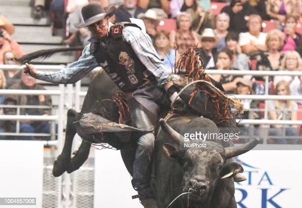 Bull rider Cody Lee Coverchuk from Meadowlake SK during the KDays Rodeo in Edmonton On Sunday July 22 in Edmonton Alberta Canada