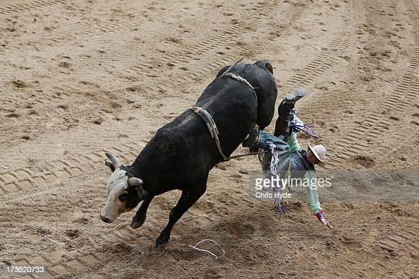 Bull rider competes in the open bull ride during the Mareerba Rodeo on July 14 2013 in Cairns Australia