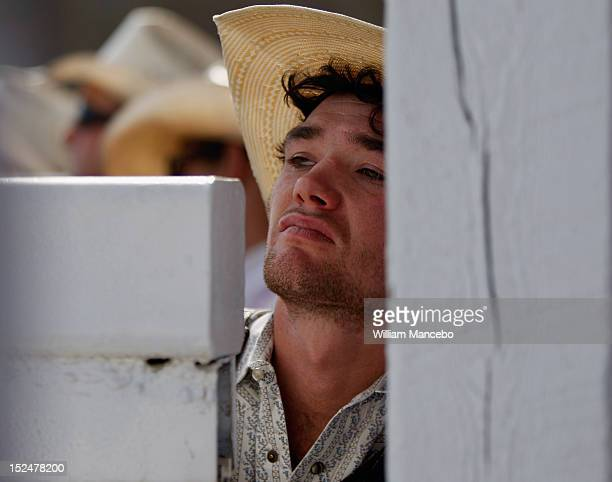 Bull rider Dallee Mason watches the action from behind the chutes while waiting for his ride at the Pendleton Roundup on September 13 2012 in...