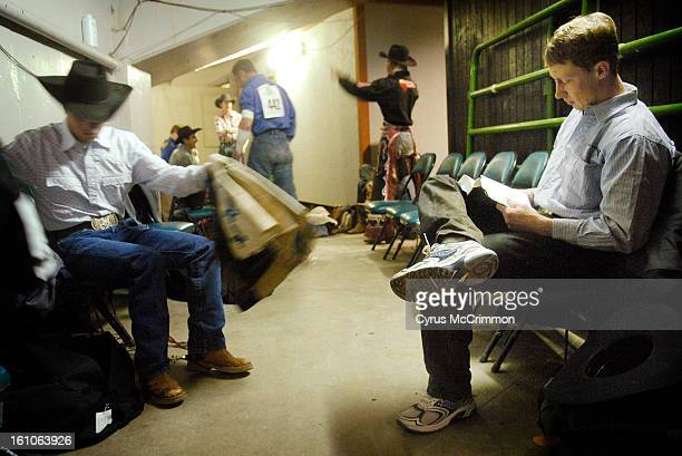 RODEO_CM01 Bull rider Lonnie Carpenter of Haysville KS does his daily Bible reading as he sits with the other cowboys in the dressing room behind the...