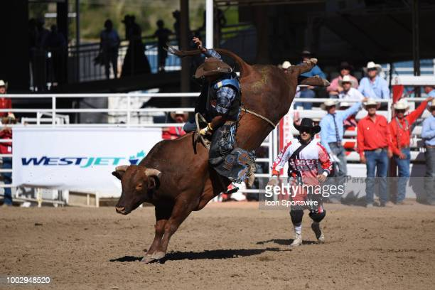 Bull rider Marcos Gloria of Edmonton AB becomes bull riding champion with this ride at the Calgary Stampede on July 15 2018 at Stampede Park in...