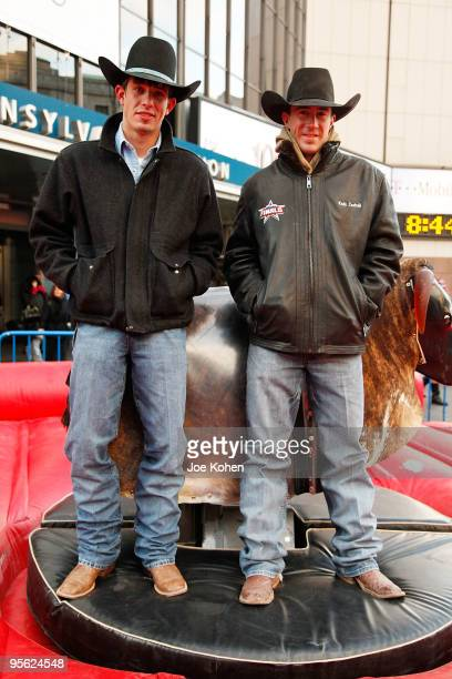Bull riders JB Mauney and Kody Lostroh attend PBR's Mechanical Bull NYC Media Showdown outside of Madison Square Garden on January 7 2010 in New York...