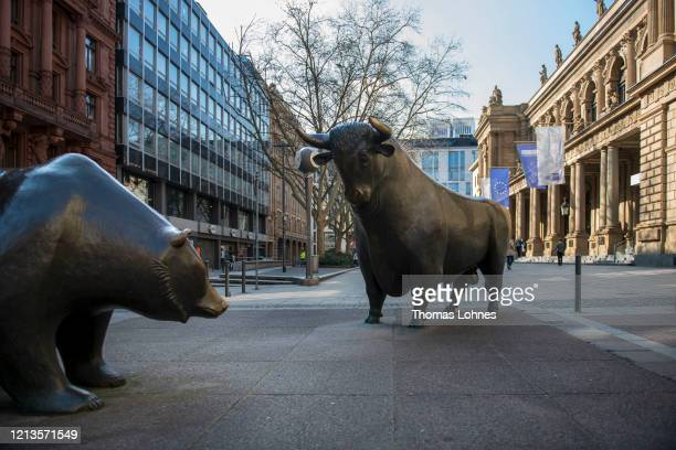Bull statue and a bear statue stand outside the Frankfurt Stock Exchange on March 19, 2020 in Frankfurt, Germany. Restrictions from the state of...