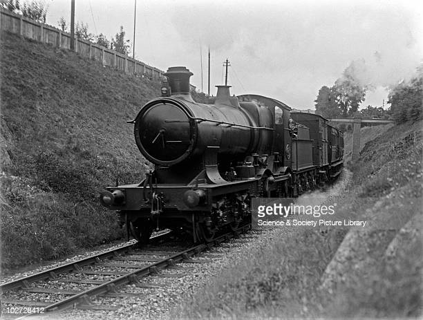 Bulldog class locomotive Great Western Railway 440 Bulldog class locomotive possibly no 3335 with horsebox and 4 wheel coaches at Newport Cutting...