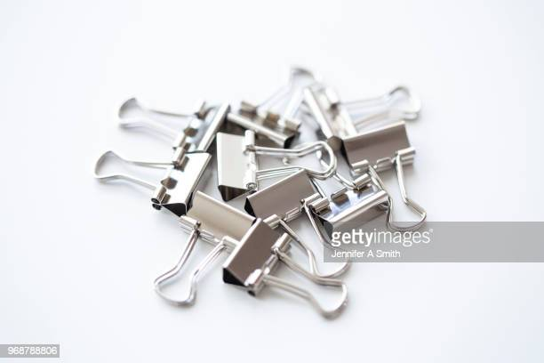 bulldog clips - clip stock pictures, royalty-free photos & images