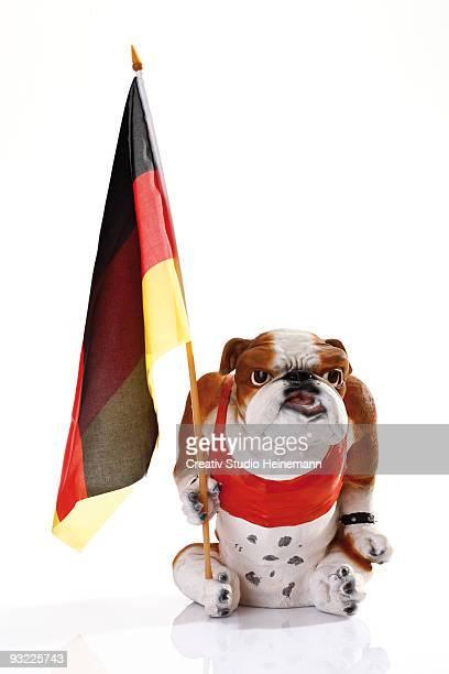 Bulldog figurine holding German flag, close-up