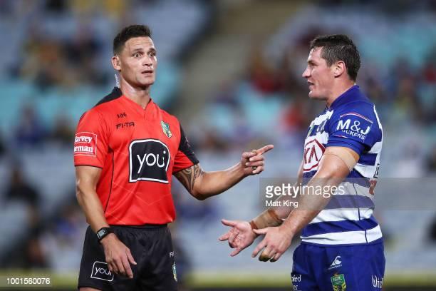 Bulldogs captain Josh Jackson talks to referee Henry Perenara after the sin binning of Brett Morris during the round 19 NRL match between the...