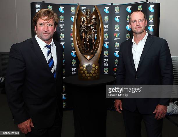Bulldogs coach Des Hasler and Souths coach Michael Maguire pose for a photo with the trophy during a press conference at the 2014 NRL Grand Final...