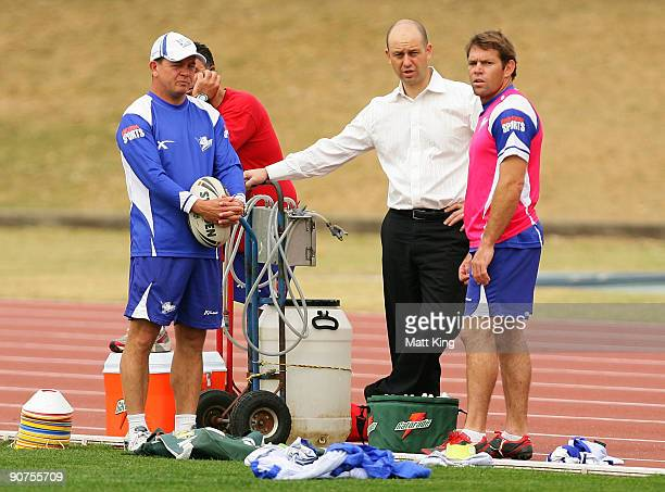 Bulldogs coach Kevin Moore Bulldogs CEO Todd Greenberg and Brett Kimmorley talk during a Bulldogs NRL training session at Sydney Olympic Park on...