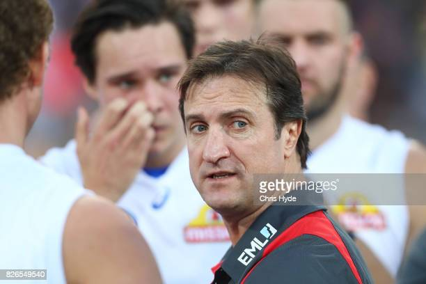 Bulldogs coach Luke Beveridge talk to players during the round 20 AFL match between the Brisbane Lions and the Western Bulldogs at The Gabba on...