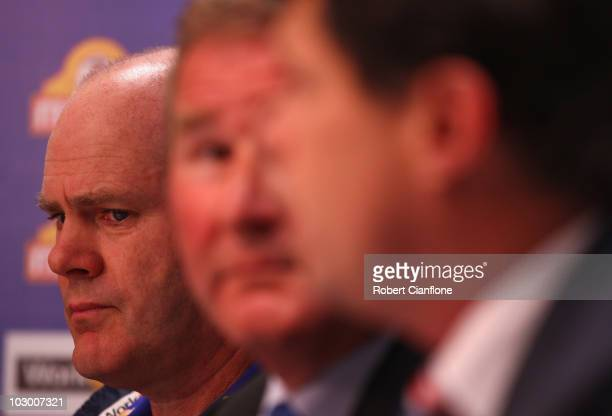 Bulldogs coach Rodney Eade listens to club president David Smorgon announce the sacking of player Jason Akermanis during a Western Bulldogs AFL press...