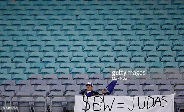 Bulldogs fan displays a sign in reference to Sonny Bill Williams in an empty section of the stadium during the round 20 NRL match between the St...