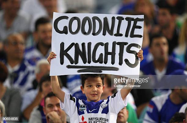 Bulldogs fan holds up a sign during the third NRL qualifying final match between the Bulldogs and the Newcastle Knights at ANZ Stadium on September...
