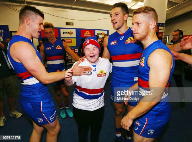 Bulldogs fan sing the club song after winning with Billy Gowers Marcus Bontempelli and Lachie Hunter of the Bulldogs during the round eight AFL match...