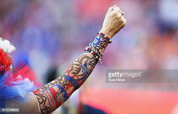 Bulldogs fan with Bulldogs tatoos cheers during the AFL First Preliminary Final match between the Greater Western Sydney Giants and the Western...