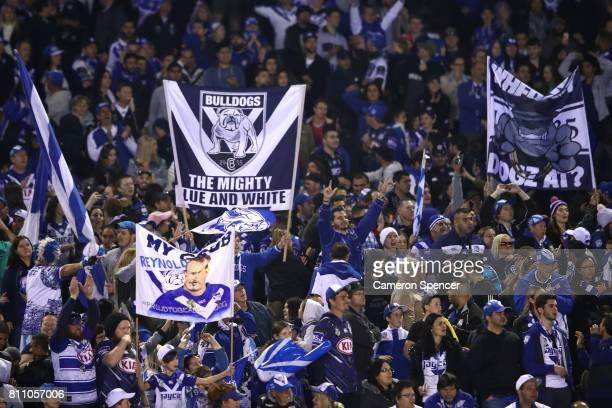 Bulldogs fans celebrate during the round 18 NRL match between the Canterbury Bulldogs and the Newcastle Knights at Belmore Sports Ground on July 9...