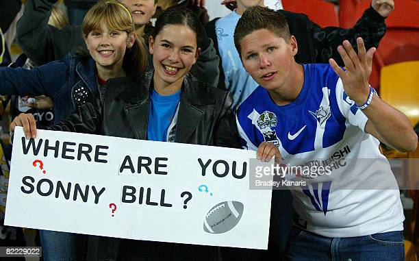 Bulldogs fans hold up a sign regarding Sonny Bill Williams during the round 22 NRL match between the Canterbury Bulldogs and the North Queensland...