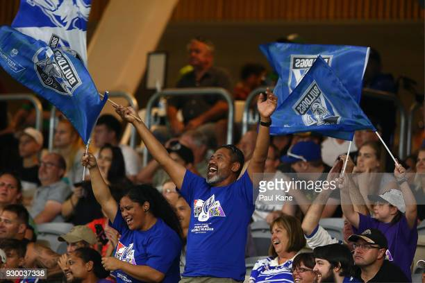 Bulldogs fans show their support during the round one NRL match between the Canterbury Bulldogs and the Melbourne Storm at Optus Stadium on March 10...