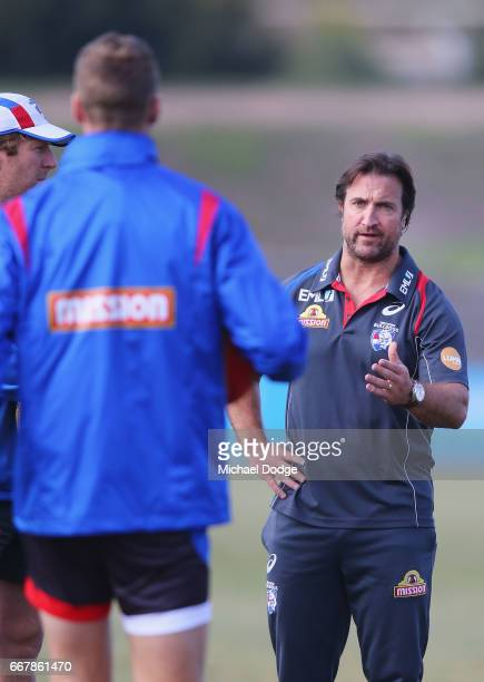 Bulldogs head coach Luke Beveridge appears to speak strongly to Jake Stringer of the Bulldogs during a Western Bulldogs AFL training session at...