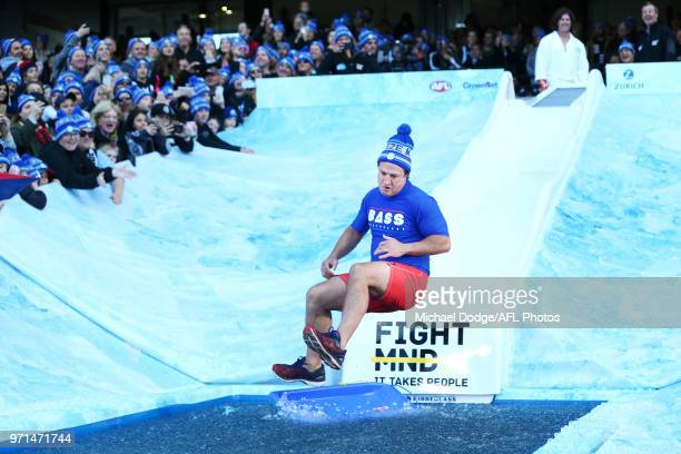 Bulldogs head coach Luke Beveridge goes down the MND slide during the round seven AFL match between the Western Bulldogs and the Gold Coast Suns at...