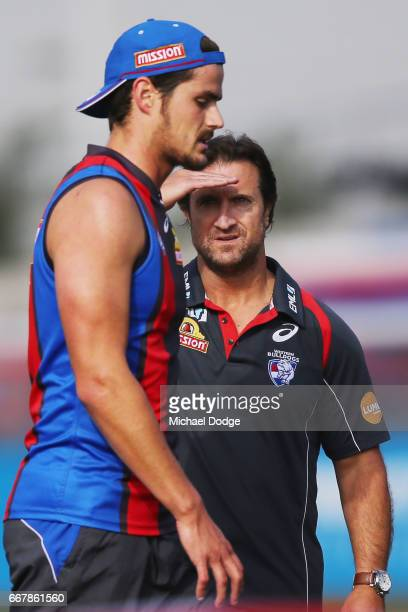 Bulldogs head coach Luke Beveridge looks at Tom Boyd of the Bulldogs during a Western Bulldogs AFL training session at Whitten Oval on April 13 2017...