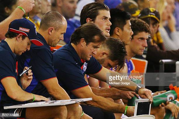 Bulldogs head coach Luke Beveridge makes moves from the bench during the round three AFL match between the Western Bulldogs and the Hawthorn Hawks at...