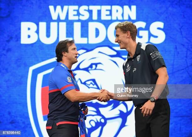 Bulldogs head coach Luke Beveridge poses with Aaron Naughton during the 2017 AFL Draft at Sydney Showgrounds on November 24 2017 in Sydney Australia